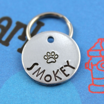 Small customized dog ID tag with paw print