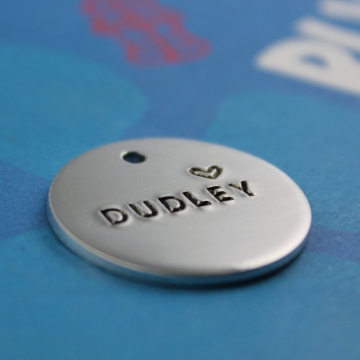 simple metal dog ID tag handstamped